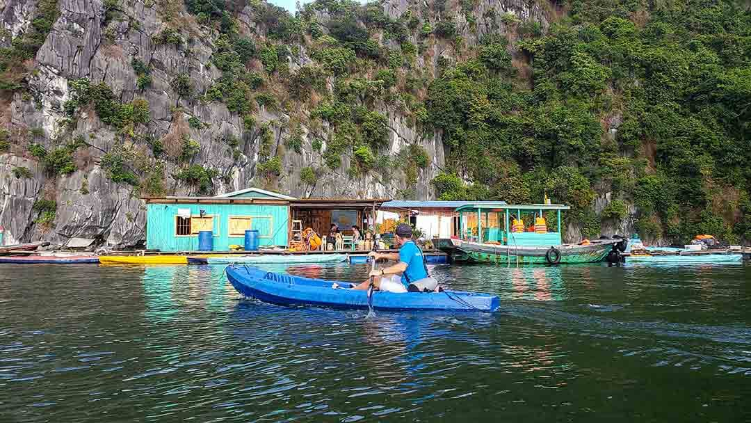 Kayaking in Halong Bay next to Floating Airbnb