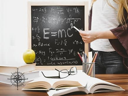 Glasses on a book with Math written on chalkboard in background