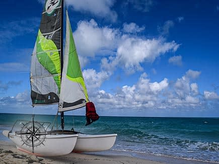 Sailboat on beach with ocean in background, Cuba